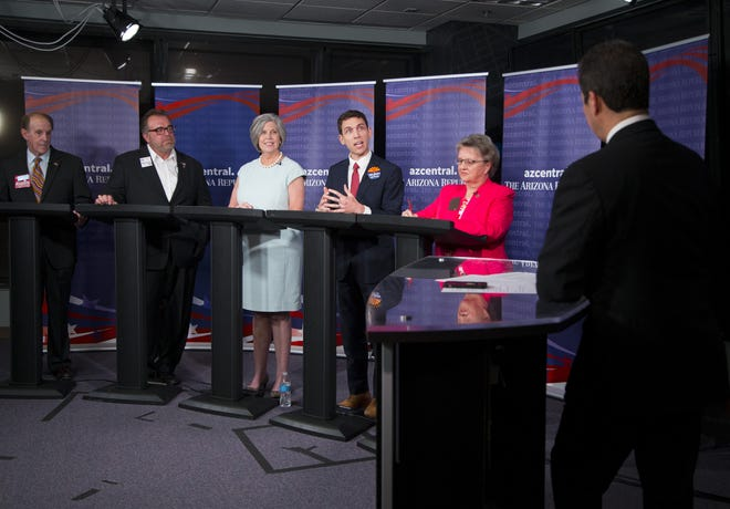 Arizona Republic reporter Richard Ruelas hosts five republicans Frank Riggs, left, Bob Branch, Tracy Livingston, Jonathan Gelbart, and Diane Douglas,  running for state superintendent of public instruction during a debate on August 1, 2018.