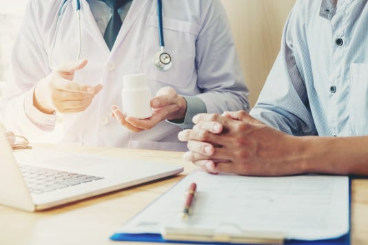 Doctor Or Physician Recommend Pills Medical Prescription To Male Patient Doctor Or Physician Recommend Pills Medical Prescription To Male Patient