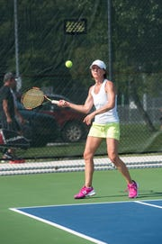 Donna Smith returns a serve while competing in the Women's 30 Double Semifinal match Thursday, Aug. 2, 2018, at the Francis J. Robinson Memorial International Tennis Tournament at Port Huron Northern High School.