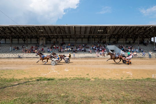From left: Pete Otten and Haberdashery, Fred Davis and Big Daddy Blitz, and Ryan Ver Hage and Elzane race each other Thursday, Aug. 2, 2018, at the Croswell Agricultural Fair in Croswell.
