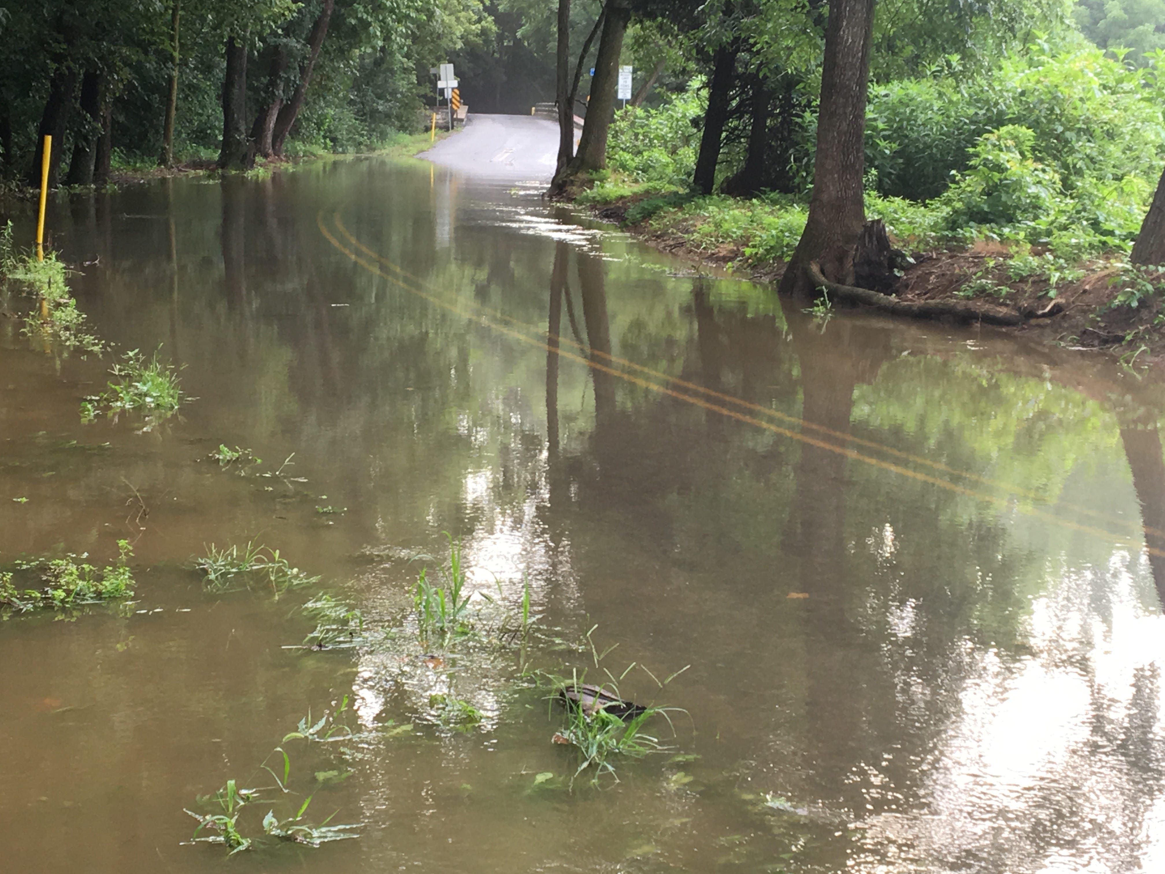 The Conodoguinet Creek flows over Hickory Run Road on Thursday morning. More rain is forecast this week.