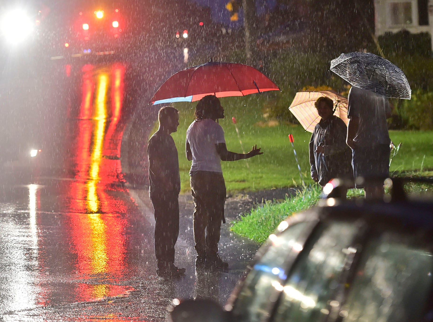 Rain continues as motorists wait for wreckers to tow their stalled vehicles at North Franklin Street after a flash flood struck the Chambersburg area on Wednesday, August 1, 2018.