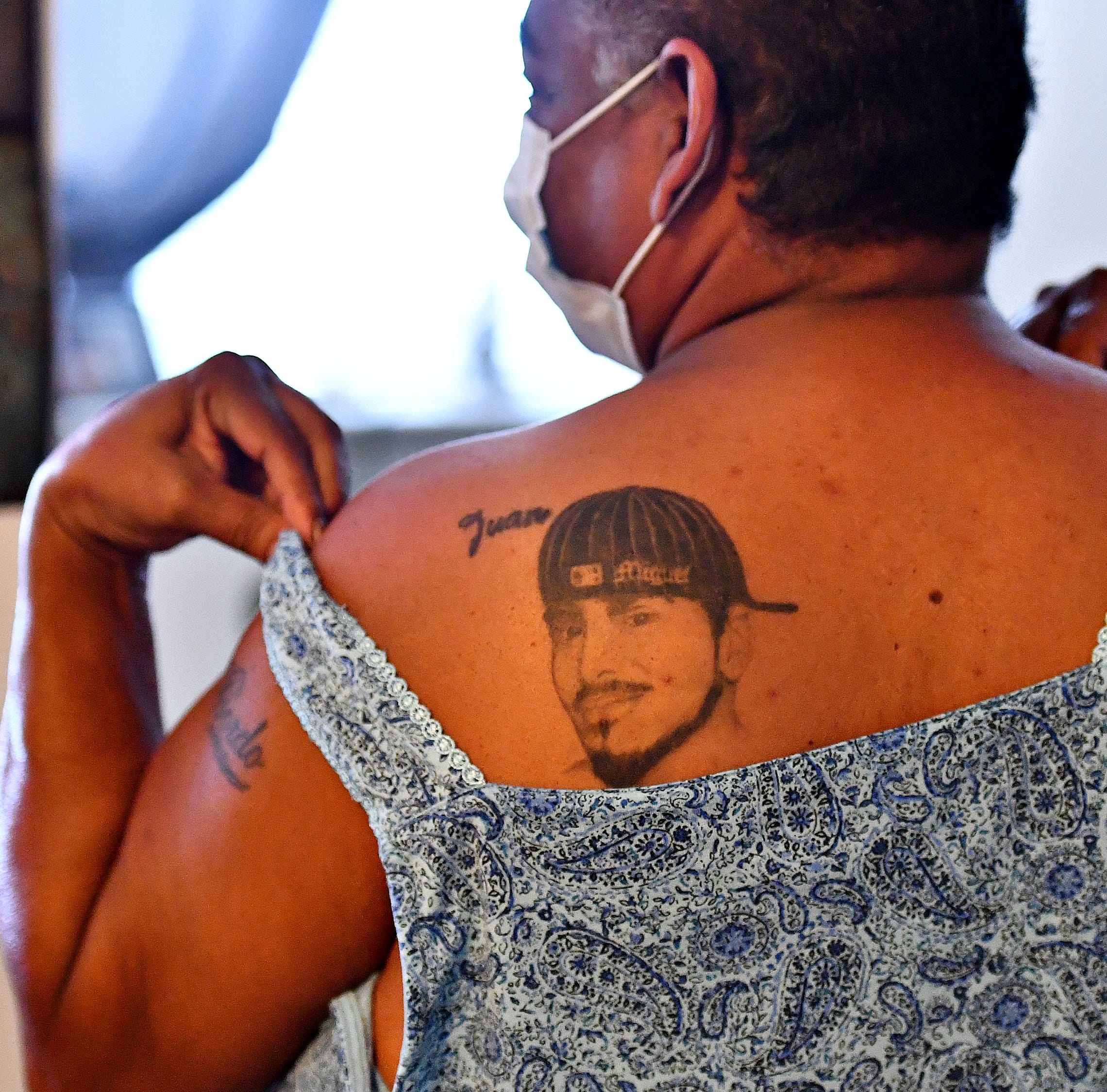 Nilda Garcia, 52, shows a tattoo that she wears as a tribute to her son Juan Miguel Laboy, 20, during an interview at her home in York City, Thursday, Aug. 2, 2018. Laboy's 12-year old murder has yet to be solved. Dawn J. Sagert