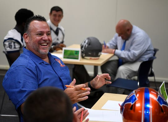 York High head coach Russ Stoner enjoys a laugh during the York-Adams League Football Media Day. Stoner's Bearcats went 1-9 in his first year at York High. In 2017, in his second season with the Bearcats, Stoner's squad went 9-2. John A. Pavoncello photo