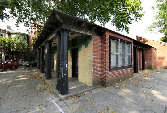 In this Tuesday, July 3, 2018 photo, the community center at Weccacoe Playground in the Queen Village neighborhood of Philadelphia stands closed. The area beneath the popular playground is a historic African-American church's burial ground, which holds the remains of more than 5,000 black Philadelphians City officials, neighbors and activists have focused on how to honor those interred while not losing the public park. The city announced plans to develop a section of the playground, demolishing the center to make room for the memorial. On Thursday, a black doll was found hanging by a noose at the playground.