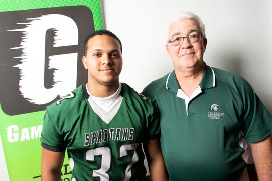 York Tech's Michael Rodriguez, left, and head coach Charlie Troxell pose for a photo during YAIAA football media day in Hanover on Thursday, August 2, 2018.