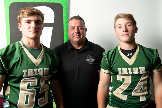 York Catholic's Jarred Kohl, from left, head coach Eric Depew and Drew Snelbaker pose for a photo during YAIAA football media day in Hanover on Thursday, August 2, 2018.