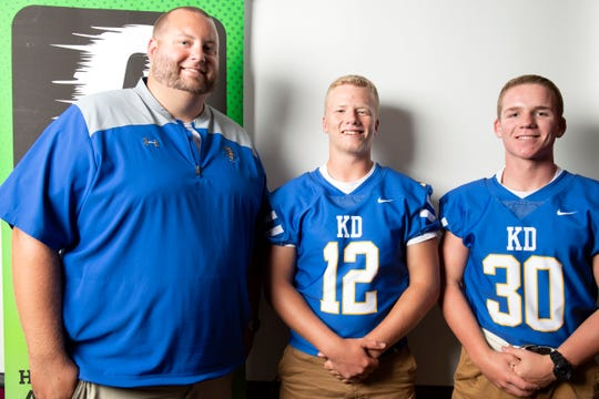 Kennard-Dale head coach Chris Grube, from left, poses with Noah Hulslander and Ryan Gibney during YAIAA football media day in Hanover on Thursday, August 2, 2018.