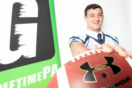 Dallastown's Raymond Christas poses for a photo during YAIAA football media day in York on Thursday, August 2, 2018.