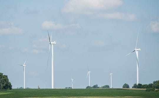 Wind turbines stand above farmers' fields in southern Randolph County on Thursday, Aug. 2, 2018.