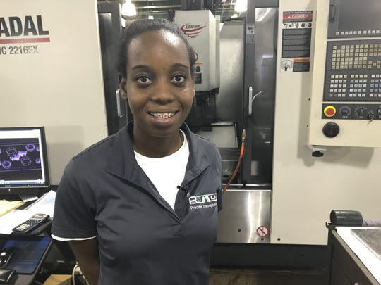 Niayah Blair was celebrated at a ceremony for being the first woman to complete the Monroe Manufactures Jobs mold making program. She is an apprentice at Romold Inc.