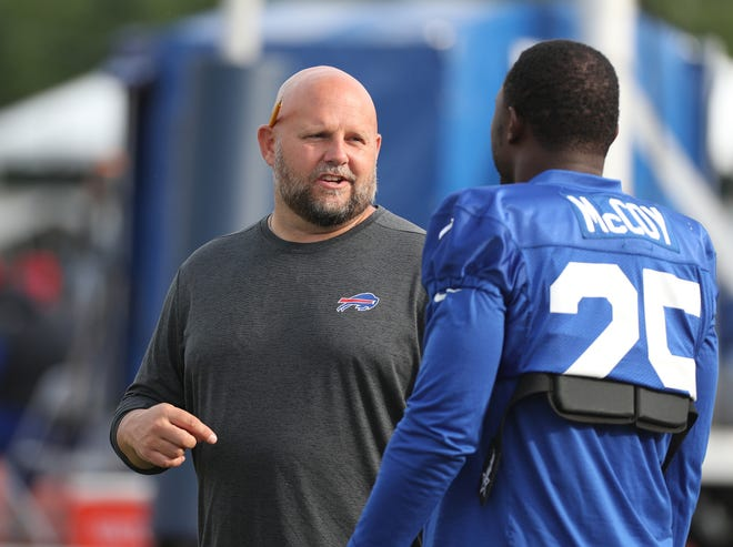 Bills offensive coordinator Brian Daboll with star running back LeSean McCoy during practice.
