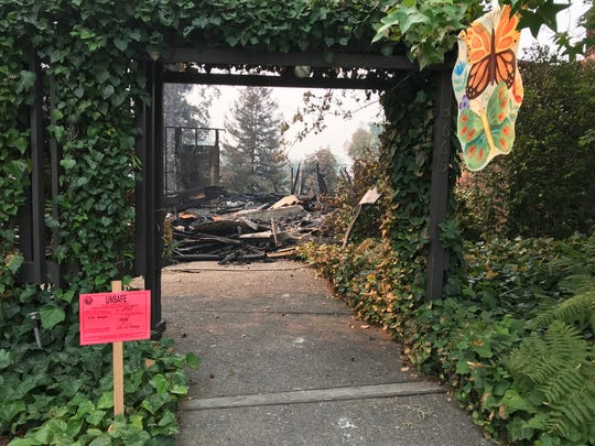Lush foliage that was untouched by the fire surrounds the entrance to a destroyed Alturas Drive home in the Sunset Terrace neighborhood in Redding. The Carr Fire destroyed nearly 1,100 homes in Redding and Shasta County.