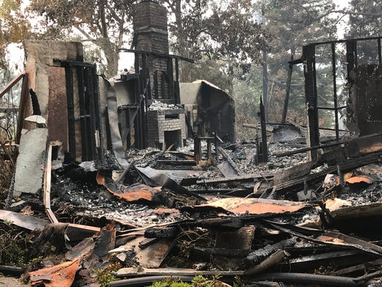 All that's left of an Alturas Drive home in the Sunset Terrace area of Redding is ruins as a result of the Carr Fire.