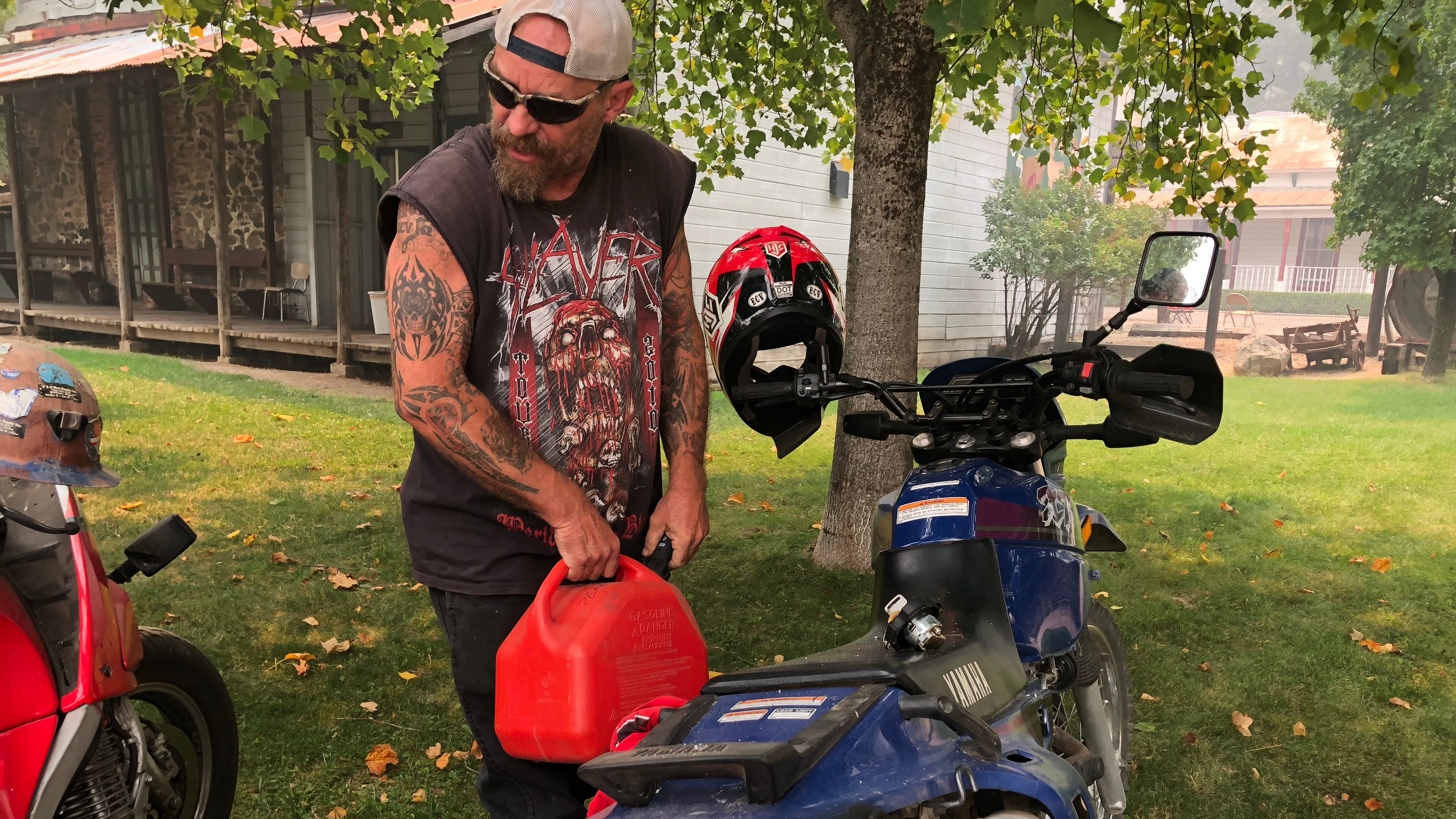 Brendan Kelly puts gas into a motorcycle in downtown French Gulch on Monday, July 30.