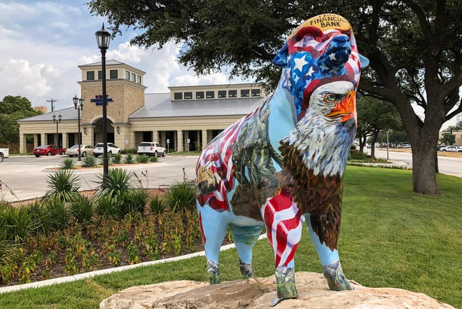 A fiberglass sheep in front of First Financial Bank in downtown San Angelo.