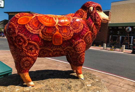 "A fiberglass sheep named ""H-E-B""ewe""tifully Woven"" at the new H-E-B in San Angelo."