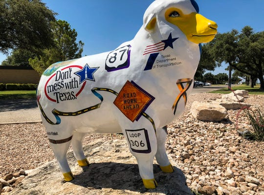"A fiberglass sheep named ""Don't EWE Mess with Texas"" in front of Texas Department of Transportation in San Angelo."