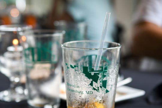 """A biodegradable straw sits in a drink at Tall Tales Brewery in Parsonsburg, Maryland. The brewery is part of Ocean City's """"straw-less summer"""" effort."""