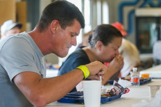 Wendell Dunbar eats lunch at the Salvation Army's Harbor House on Thursday, Aug. 2, 2018.