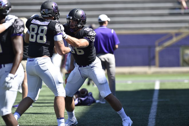 James Madison's Mack Cullen, right, a Wilson Memorial alumnus, warms up with teammate Jonathan Kloosterman before the Dukes' game with Maine on Sept. 23, 2017. Cullen counts Kloosterman as a huge influence and inspiration .