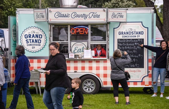 People make their decisions from several food trucks on hand during Summertime by George! Wednesday, Aug. 1, in St. Cloud.