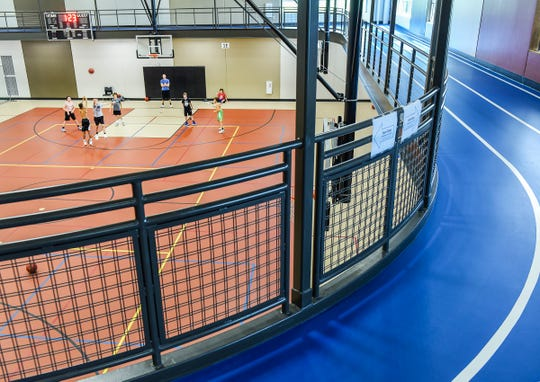 A walking track rings the basketball courts at the Sartell Community Center,  shown Thursday, Aug. 2, in Sartell.