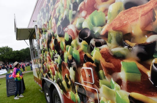 Colorful graphics on the Papa Murphy's food truck draw customers during Summertime by George! Wednesday, Aug. 1, in St. Cloud.