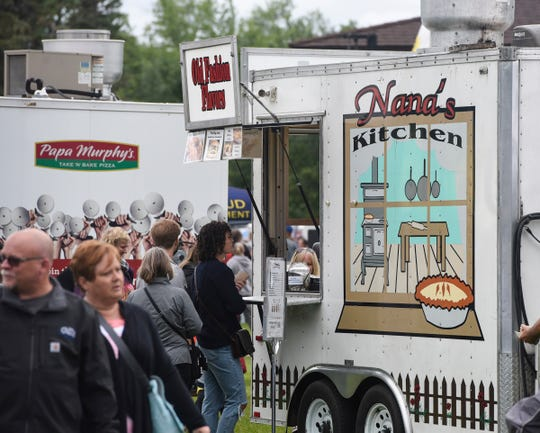 Customers line up in front of the Nana's Kitchen truck during Summertime by George! Wednesday, Aug. 1, in St. Cloud.