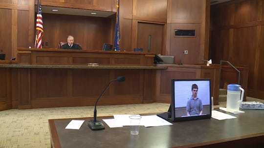 Martin Farnsworth appears in court via closed-circuit television Tuesday, July 31, 2018.