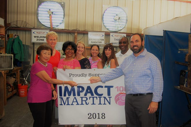 Impact 100 Martin Executive Chair Nancy Wong, left, presents the first grant installment check to Robert Zaccheo, right, executive director of Project LIFT. Looking on are, from left, Denise Belizar and Arati Hammond, Impact 100 Martin; Robin Cartwright, Martin County Community Foundation; Genevieve George, Impact 100 Martin; Elizabeth Barbella, president and CEO of Martin County Community Foundation; and Adam Jolly, Project LIFT.