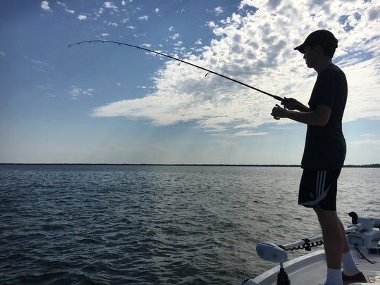 Leo enjoying catching lots and lots of ladyfish!