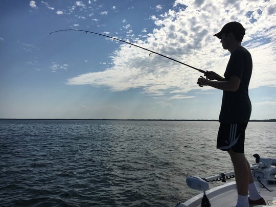 Leo enjoying catching lots and lots of ladyfish!