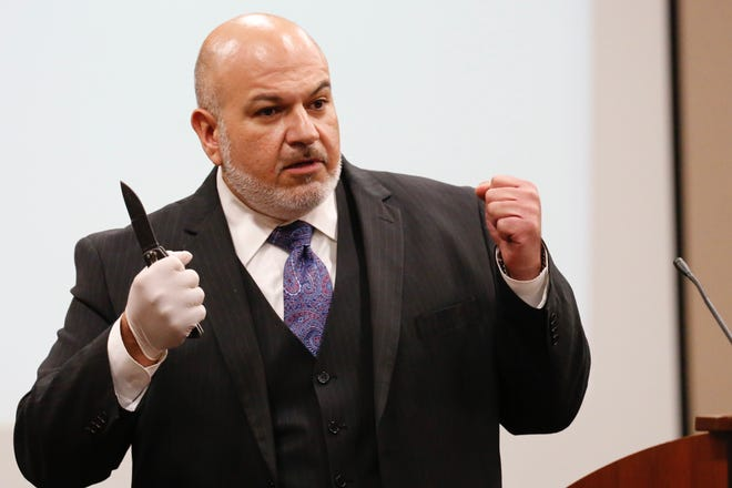 Defense attorney Marcelo Rivera holds up a knife during closing statements in the Hisaias Justo Lopez trial. Lopez was on trial in the death of U.S. Border Patrol Agent Isaac Morales, 30, on May 20, 2017, in the parking lot of the Union Draft House in East El Paso.