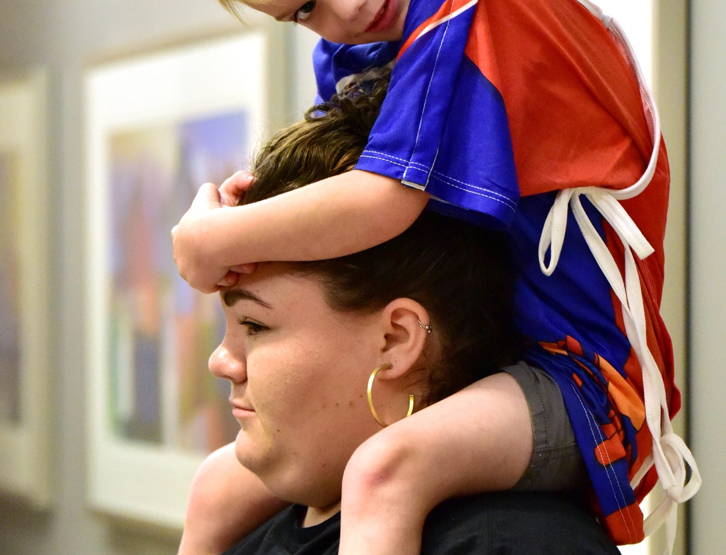 Carson Bradley, 5, sits on the shoulders of Haley Mackey during a Superhero Kids' Fashion Show held by the Dunkin' Donuts Joy in Childhood Foundation at Greenville Memorial Hospital on Thursday, August 2, 2018.