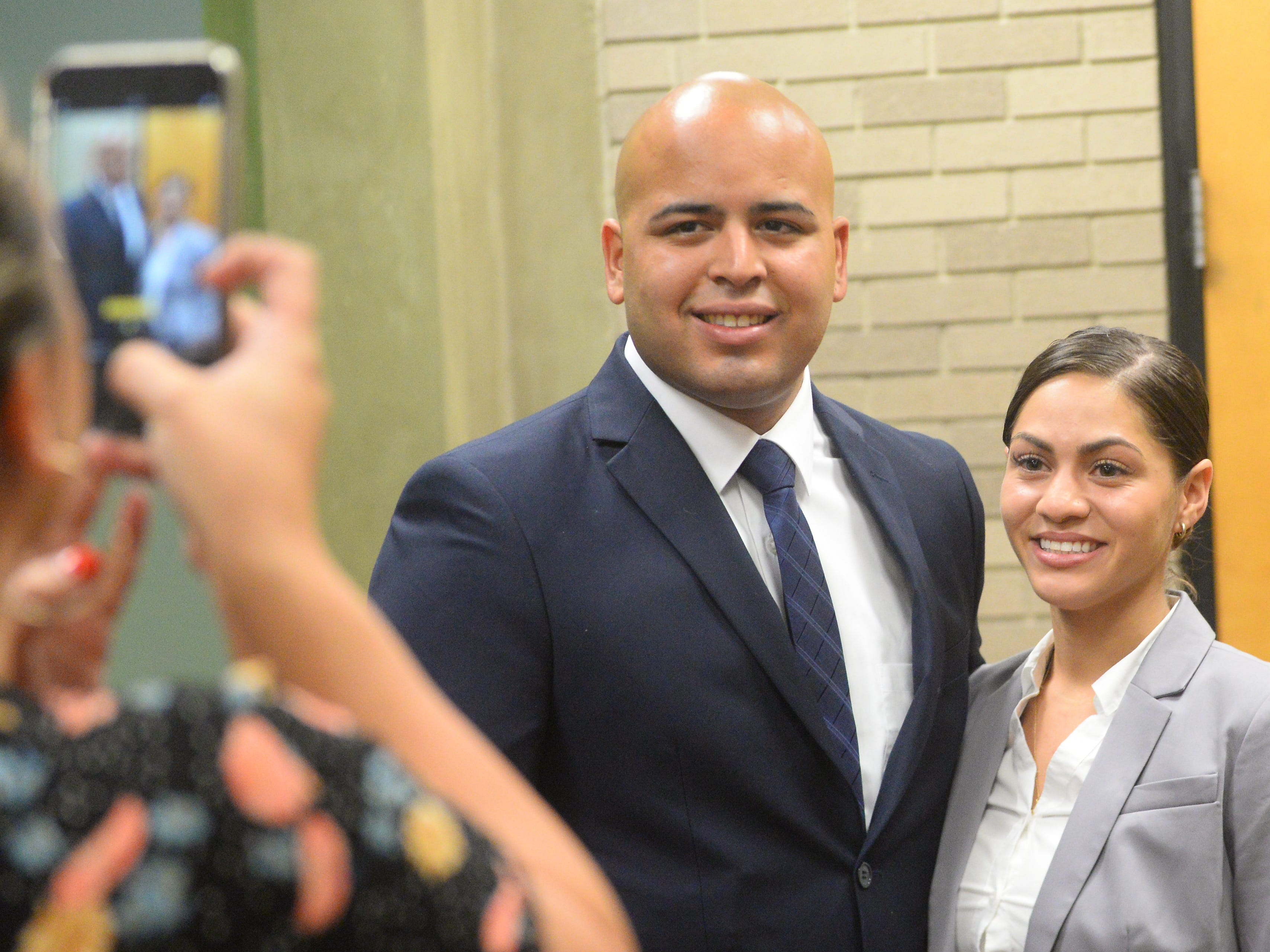 Kyle J. Arbona and Kaylene Cosme, two of three new Vineland Police recruits, pose for photos after being sworn in at City Hall on Thursday, August 2.