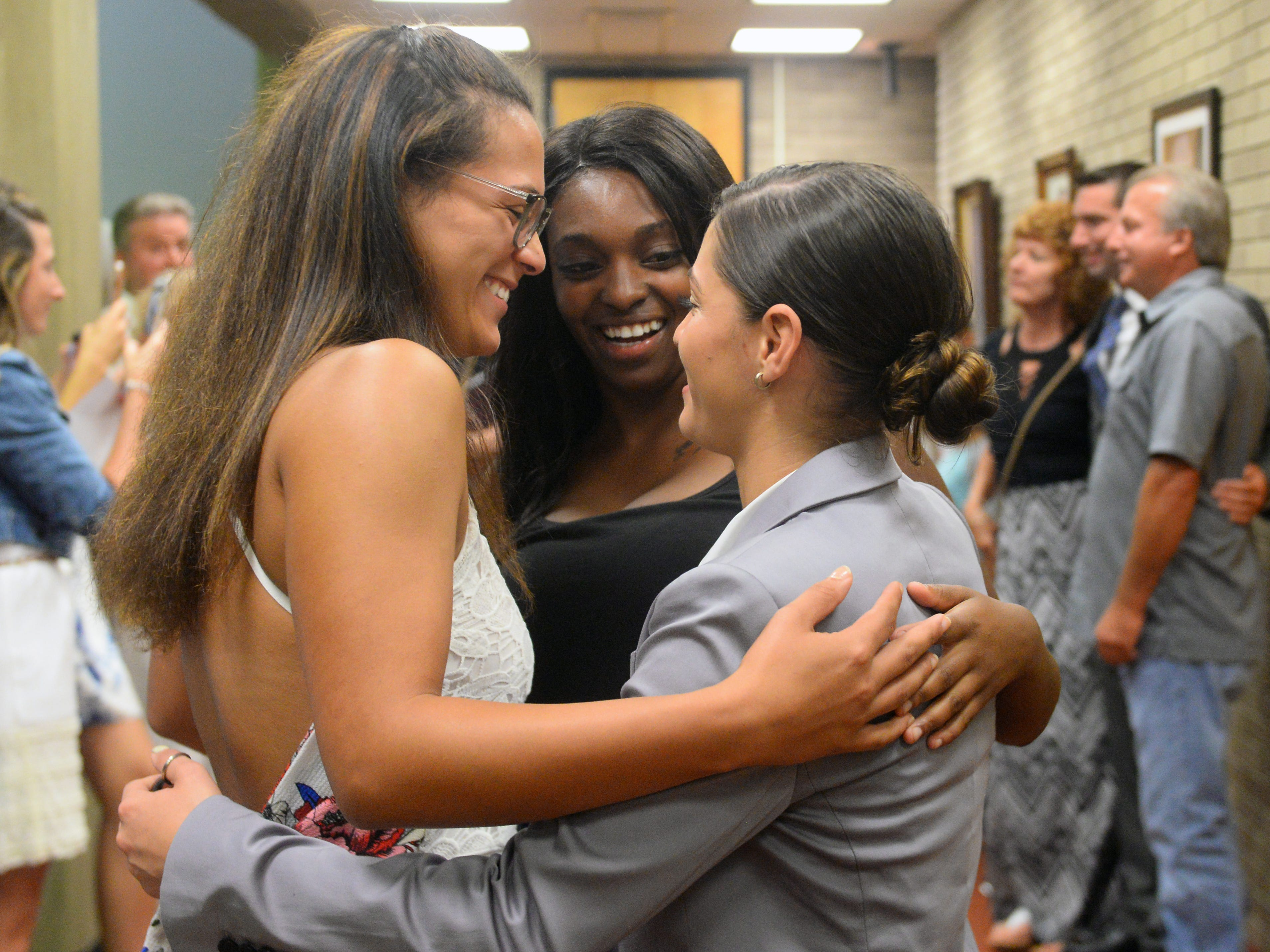 Kaylene Cosme (right) celebrates with her sister (left) Niyah Cosme and friend Cherelle James after being sworn in as a Vineland police recruit at Vineland City Hall on Thursday, August 2.