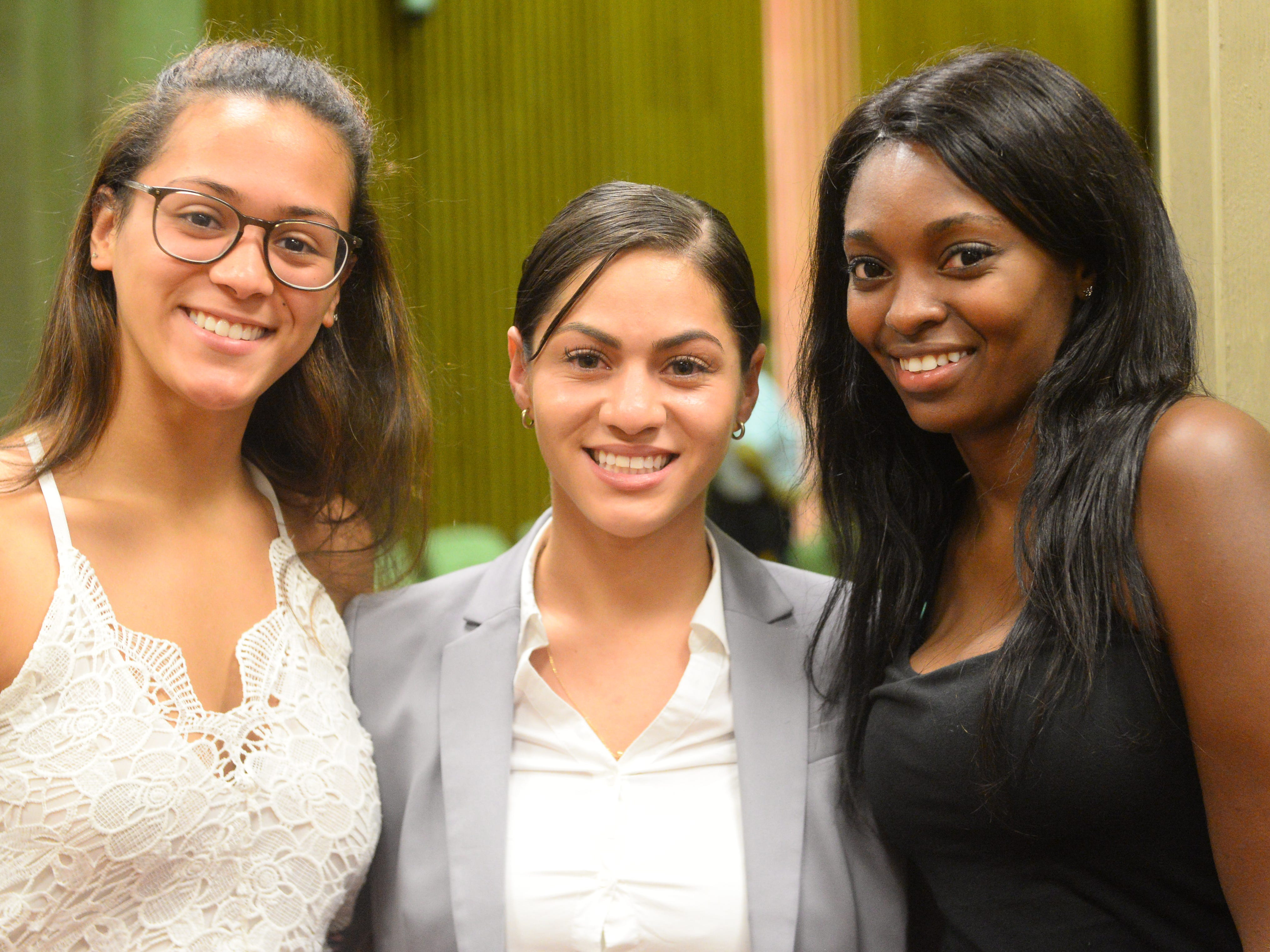 Kaylene Cosme (center) celebrates with her sister (left) Niyah Cosme and friend Cherelle James after being sworn in as a Vineland police recruit at Vineland City Hall on Thursday, August 2.