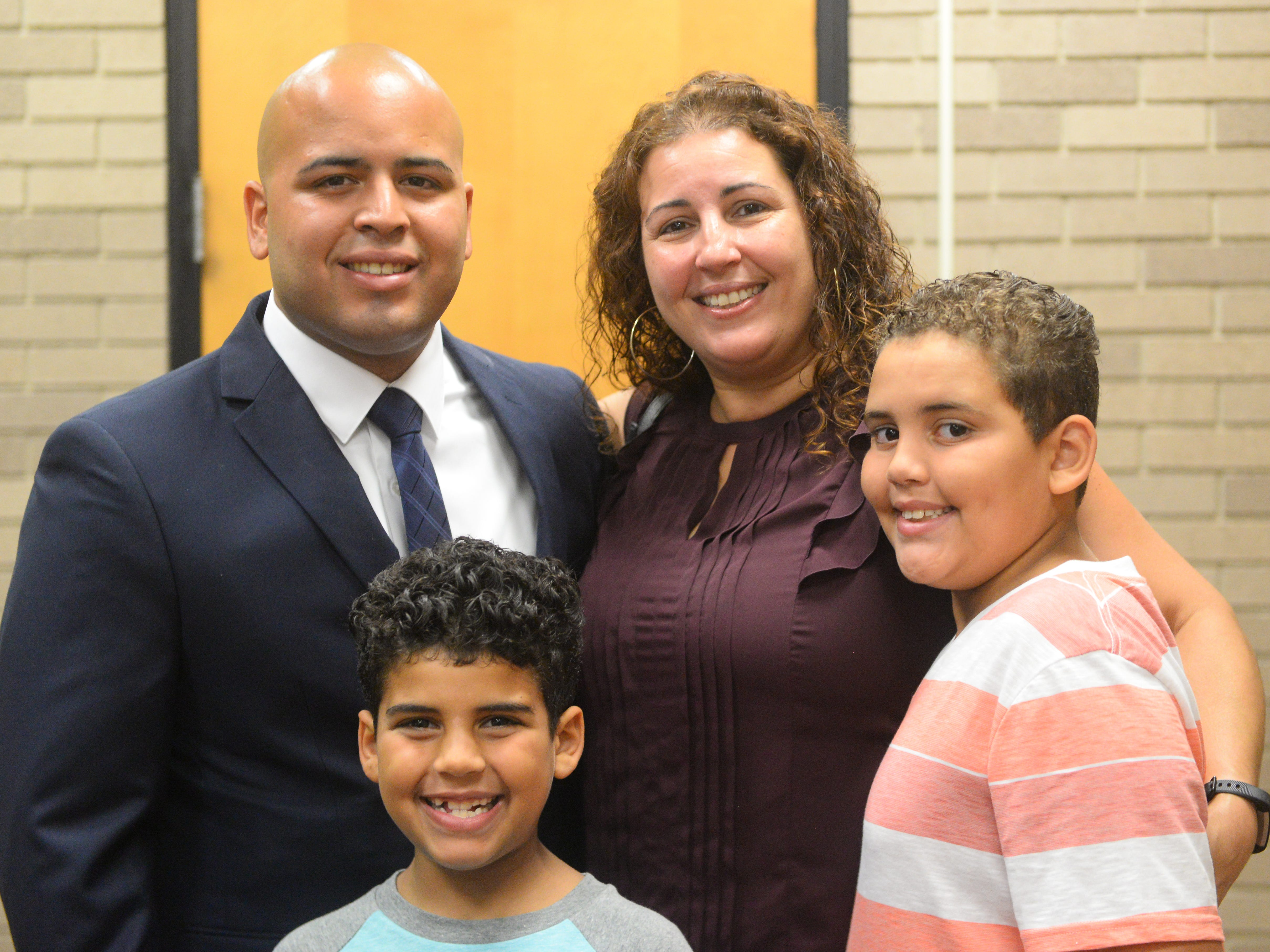 Kyle J. Arbona, 25, celebrates with family after being sworn in as a Vineland police recruit at Vineland City Hall on Thursday, August 2.