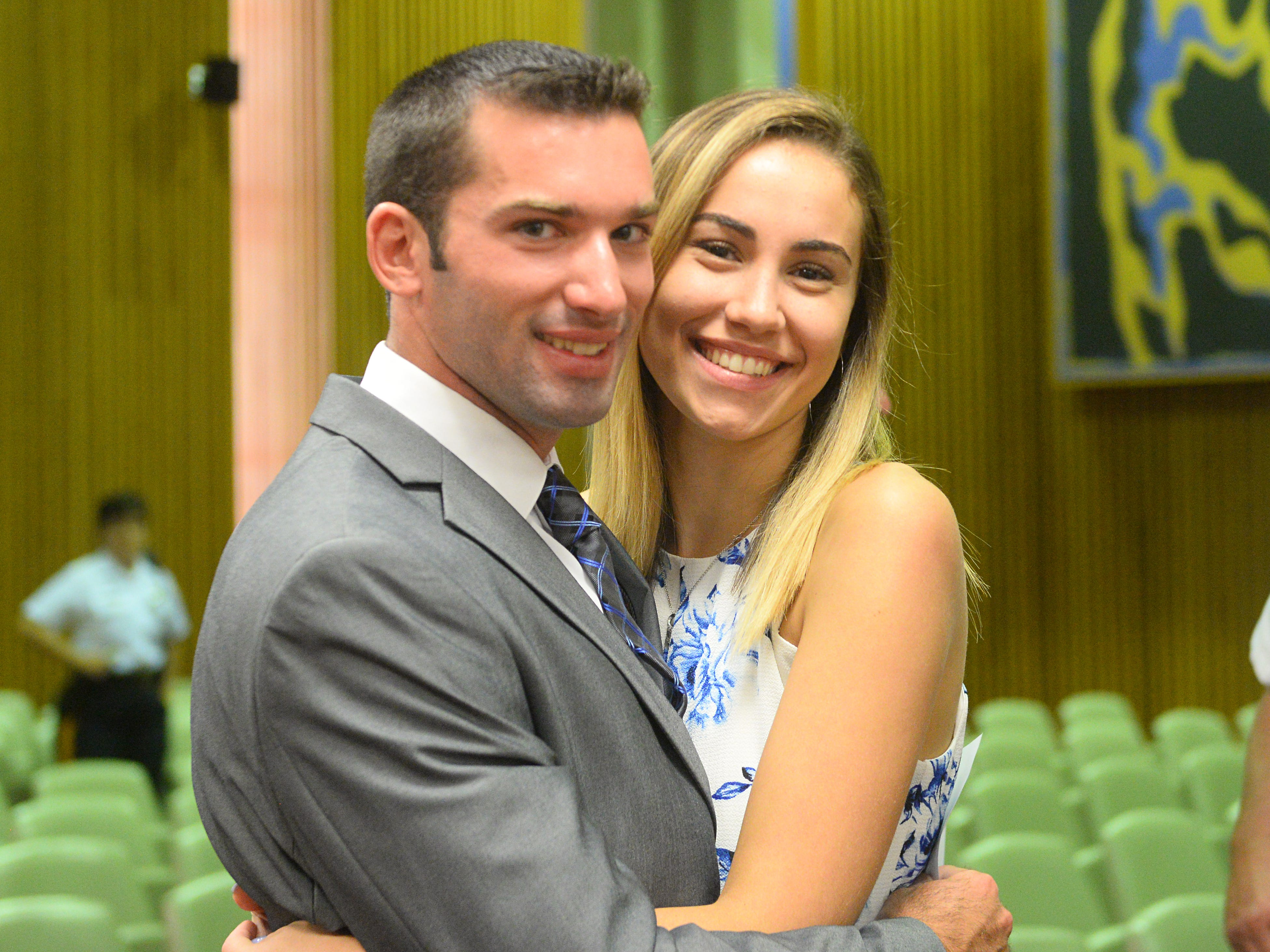 Daniel Miller Jr., 23, celebrates with his girlfriend, Nicole Pooley, after being sworn in as a Vineland police recruit at Vineland City Hall on Thursday, August 2.