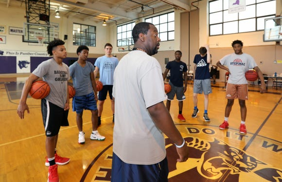 Coach Tyrone Carver of Mamaroneck talks with the Hudson Valley boys basketball team during a practice at the Masters School in Dobbs Ferry Aug. 1, 2018. They will be competing in the BCANY Summer Hoops Festival in Johnson City Aug. 3-5.