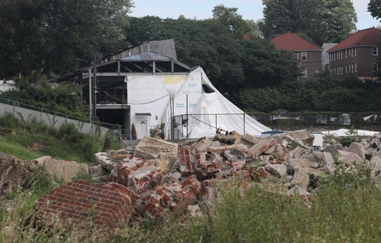 The deflated bubble from the Mount Vernon Tennis Center and the demolished grandstand, foreground, are seen at Memorial Field, Aug. 2, 2018.