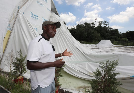 Kela Simunyola, the owner of Kela Tennis, stands next to the deflated bubble from the Mount Vernon Tennis Center at Memorial Field, Aug. 2, 2018.