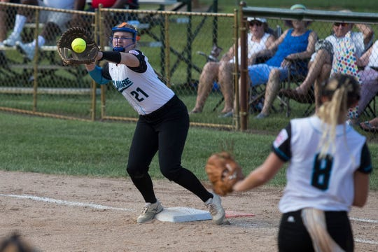 Delaware's Amanda Coates catches a ball at first base during their last game of pool play against Asia-Pacific Thursday at the Lower Sussex Little League Complex in Roxana. Georgetown defeated Asia-Pacific 8-4.