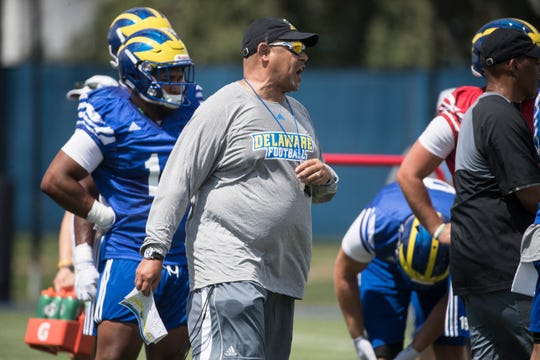 Delaware offensive coordinator Matt Simon gives instructions during practice.