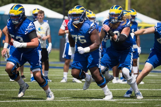 Delaware's Chuka Ezeuzoh, 75, runs through plays with the offense during practice Wednesday, Aug. 1.