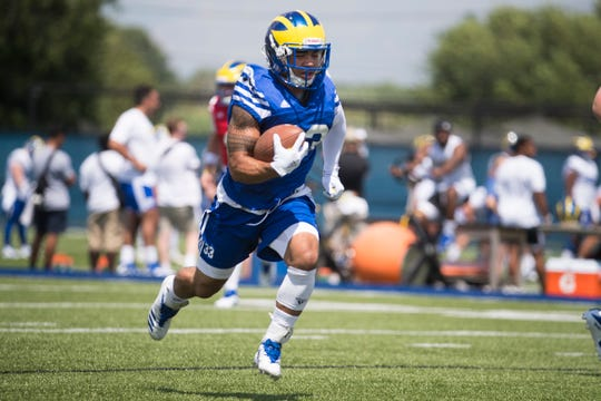 Delaware's Dejoun Lee, 33, breaks downfield during practice Wednesday at the Blue Hens training field.