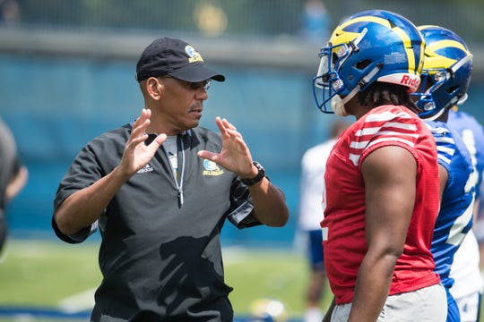 Delaware Quarterback Coach Alex Wood works with quarterback Darius Wade during practice Wednesday at the Blue Hens training field.