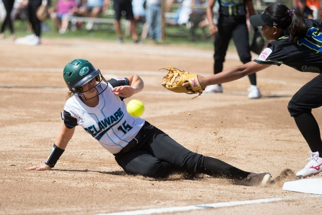Georgetown's Ryleigh Elliot, 15, slides into third base during their last game of pool play against Asia-Pacific Thursday at the Lower Sussex Little League Complex in Roxana. Georgetown defeated Asia-Pacific 8-4.