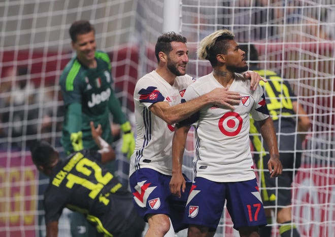 MLS forward Josef Martinez (17) celebrates with teammates after scoring a goal against Juventus in the first half in the 2018 MLS All Star Game at Mercedes-Benz Stadium.